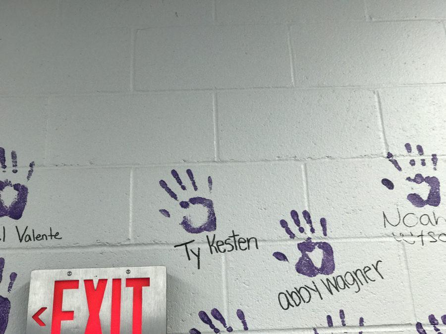 Handprint for Kesten added to senior wall