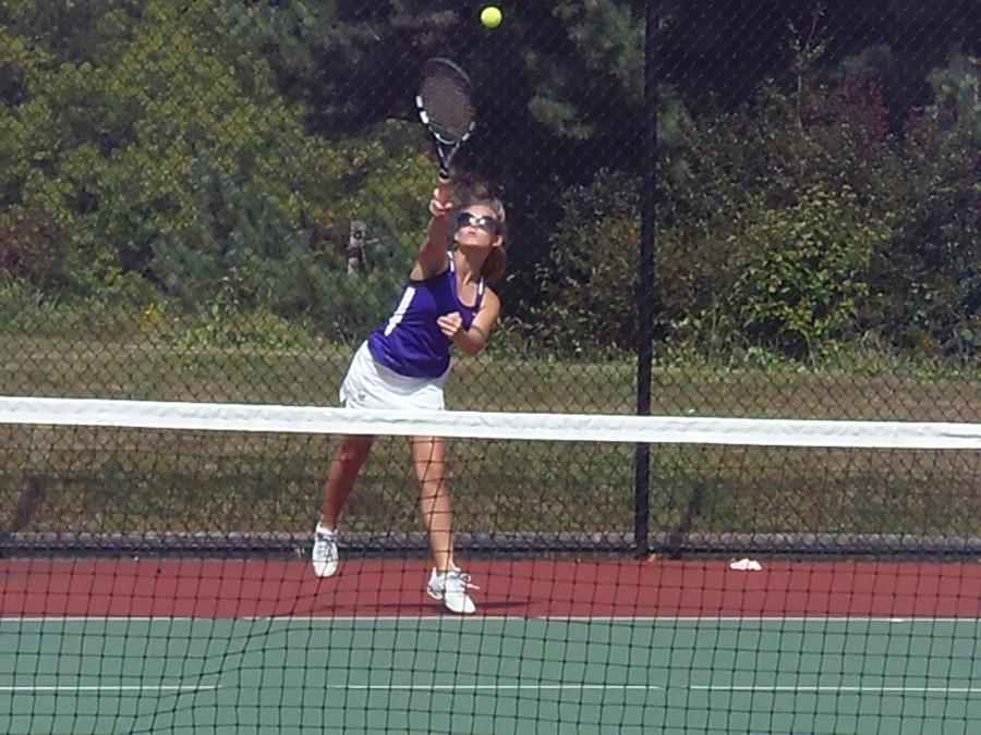 Returning+the+favor%3A+Sophomore+Morgan+Shaming+hits+the+ball+bak+to+her+opponent+in+section+doubles+at+Baldwin+%2C+Sept.+25.+The+girls+tennis+team+showed+much+improvement+from+previous+seasons.