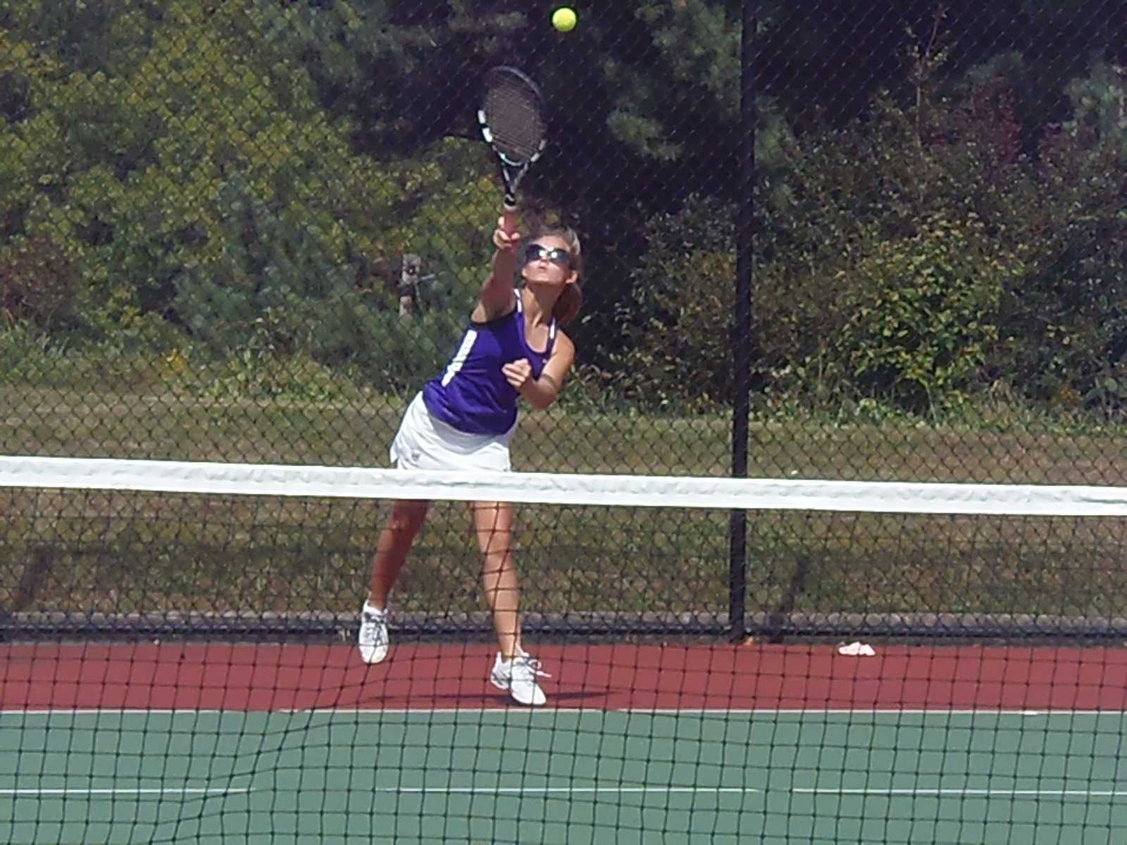 Returning the favor: Sophomore Morgan Shaming hits the ball bak to her opponent in section doubles at Baldwin , Sept. 25. The girls tennis team showed much improvement from previous seasons.