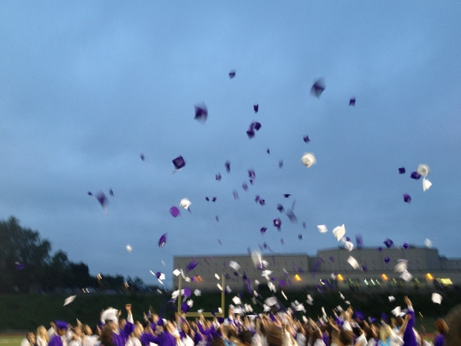 Graduation caps are tossed into the air at the end of a previous Baldwin graduation.