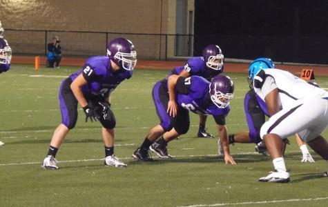 Football players face off at Baldwin High School football game.