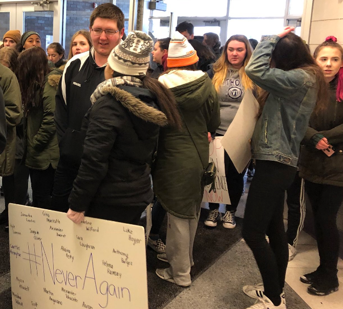 Walkout students signing back into school building.