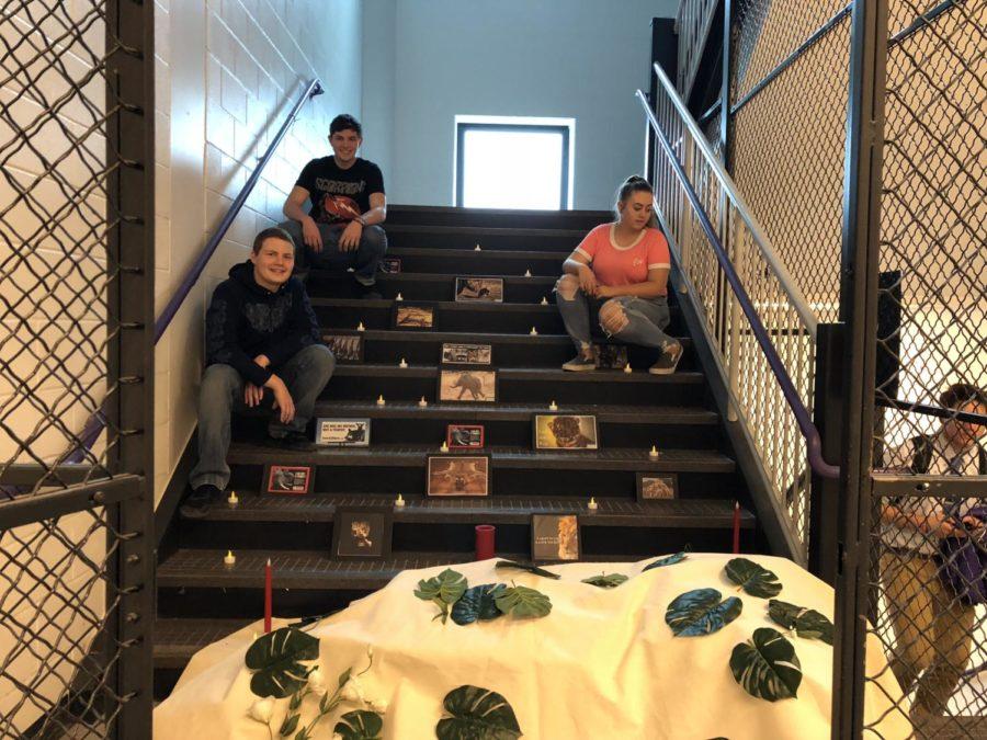 Juniors+Derek+Kotecki%2C+Bridget+Stehle%2C+and+Anthony+Provident+sitting+with+their+art+installation.