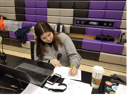 Hard at work: Claire Plunkett does announcing for a bocce tourney. Her parents inspired her to join Special Olympics.
