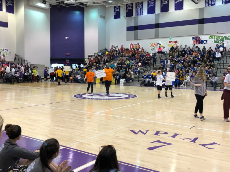 Summer+Games+bring+smiles%3A+%0AStudents+walk+across+the+gym+%28above%29+at+opening+ceremonies.+The+games+featured+several+hundred+athletes.+