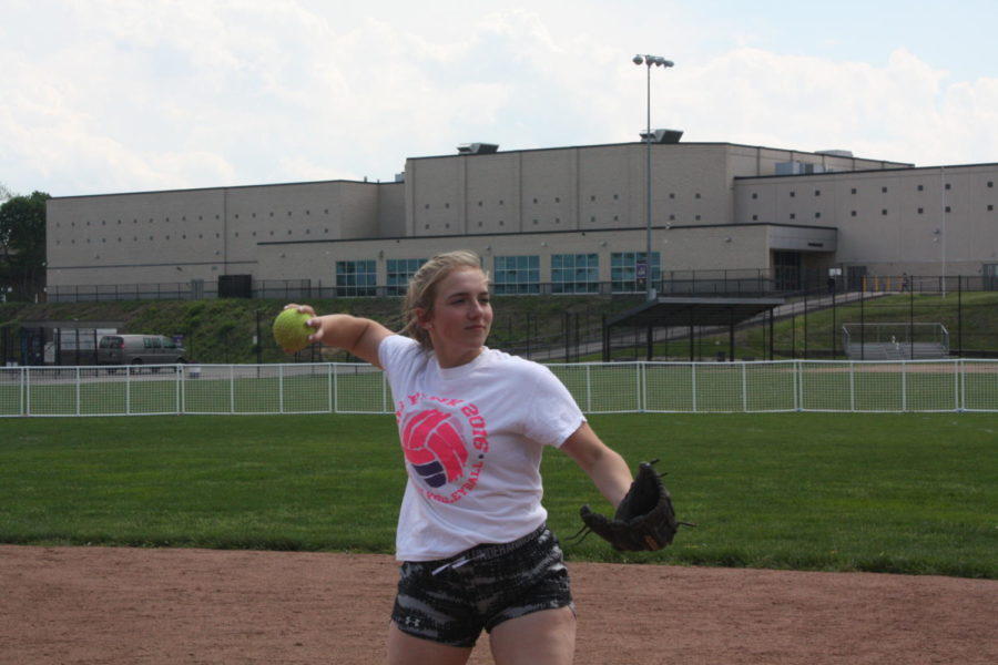Making+the+play%3A+Junior+Cassie+Carlson+throws+to+first+base+in+practice.+The+team+has+finished+in+first+place+for+four+consecutive+years+in+its+section.
