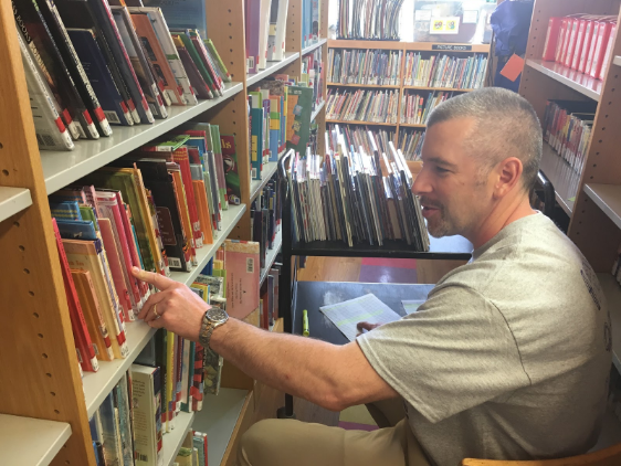 Helping out: Teacher Dale Kreuer help out at the Whitehall Public Library. Staff and students completed service projects throughout Baldwin, Whitehall and the region during the district's first Day of Caring.