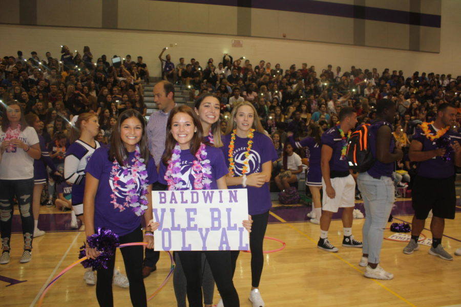 Girls+volleyball+team+poses+for+a+picture+at+the+Fall+pep+rally.