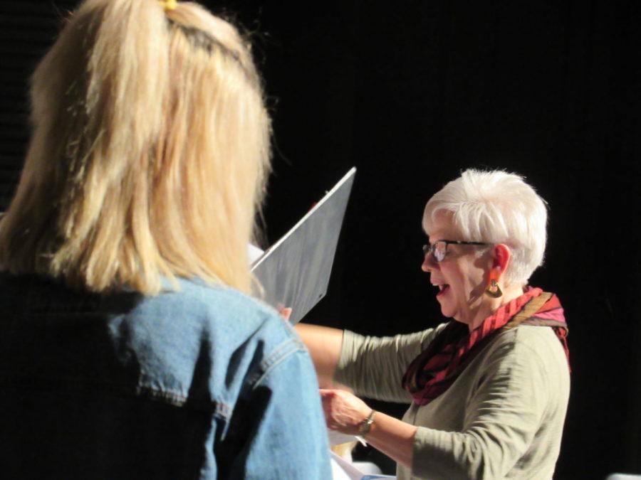 PMEA Choir director leads practice