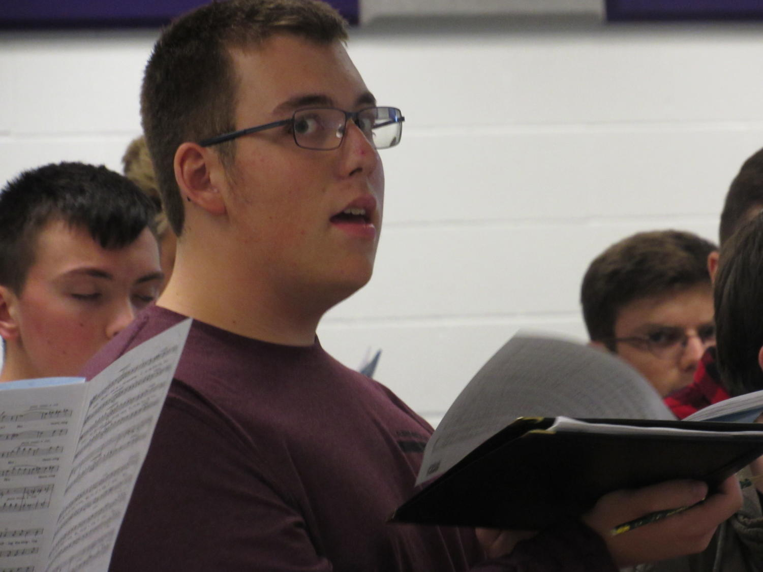 Boy's PMEA choir rehearses, the event came to Baldwin this year.