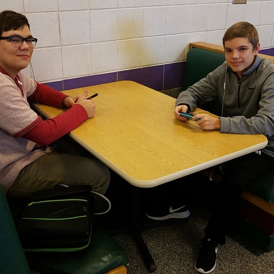 Seniors Ben Daly (left) and Evan Rector sit in the cafeteria at the cafeteria.