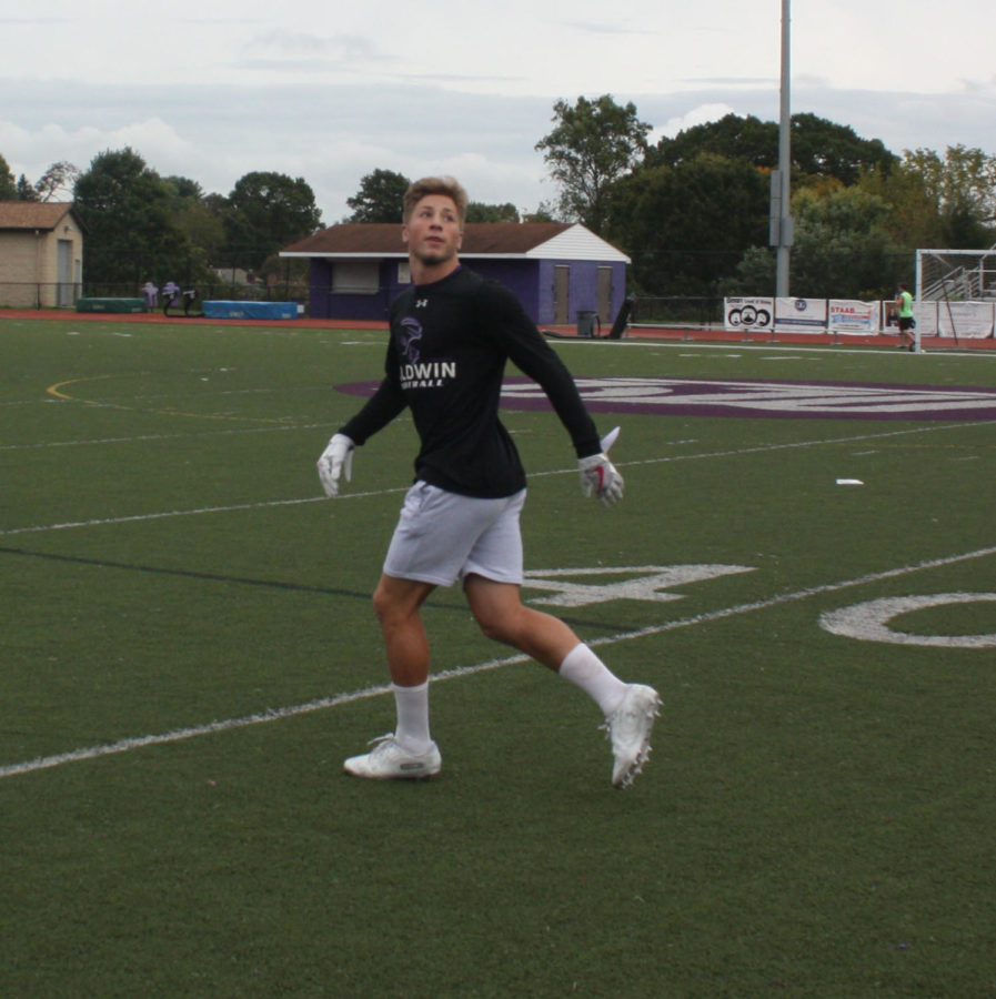 Friday night lights: Junior Jarren Kelly receives a pass during practice. The Highlanders made improvements this season.
