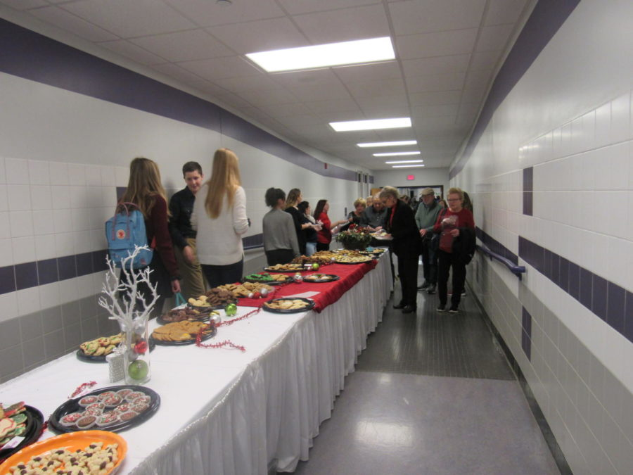 Senior citizens take cookies at the Cookie Extravaganza at the high school.
