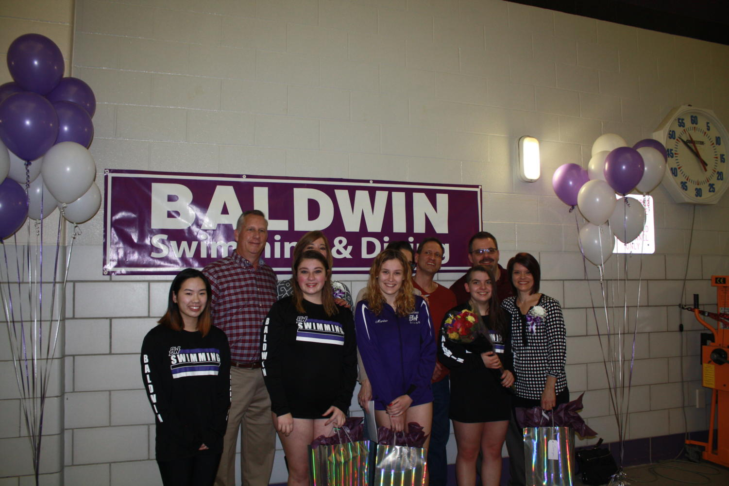 The celebrated seniors were Announcer Quinn Scharding, and swimmers Katelyn Meyers, Valerie Marino, and Camryn Beveridge.