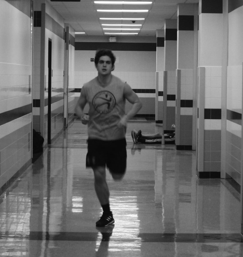 One of the O'Malley twins, Brendan, practices during the winter track season by running in the halls.