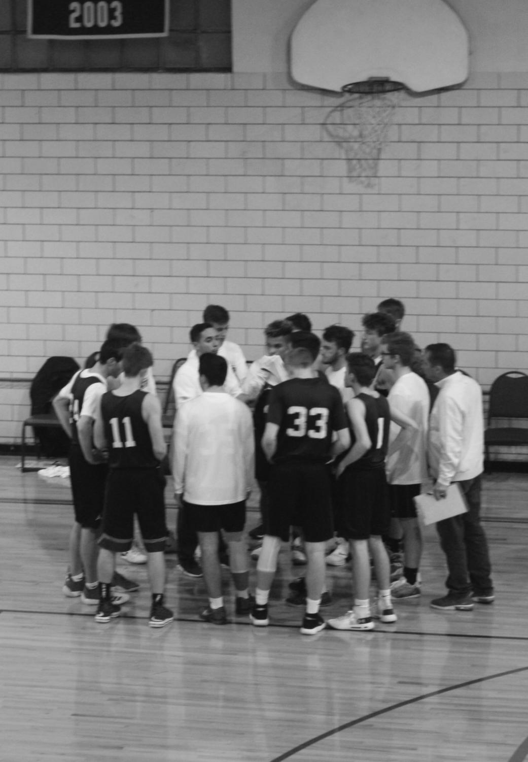 A league of their own: The St. Elizabeth team takes advice from Coach Gary Remlinger. Both the St. Elizabeth and St. Gabriel teams have students playing.