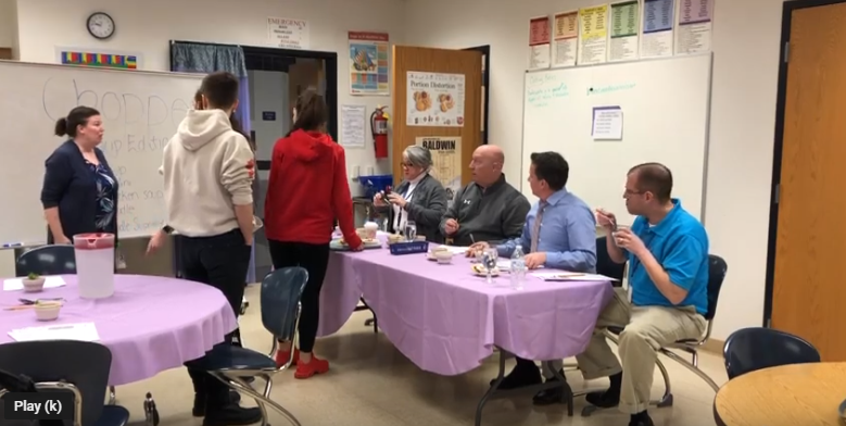 Assistant Superintendent Denise Sedlack, Athletic Director John Saras, music teacher Kris Tranter, and math teacher Rich Fochtman judge the students soups.