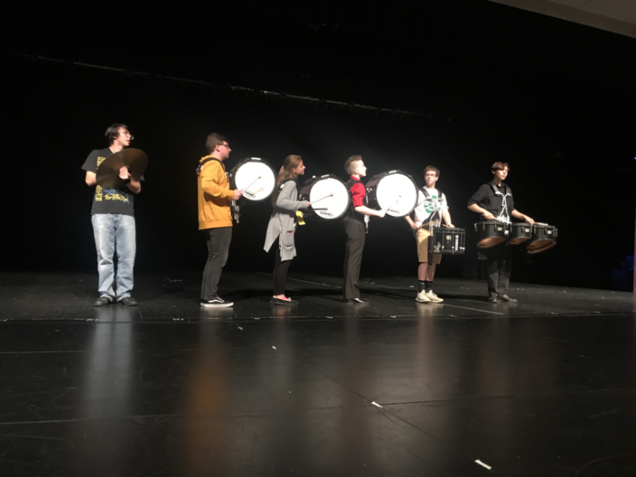 Baldwins marching bands drum line performs at the talent show.