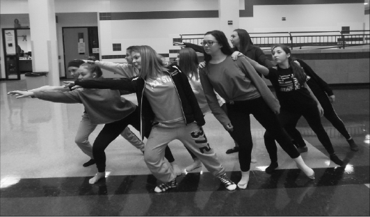 Getting back in action: Members of the Baldwin dance team rehearse a routine in the atrium. The high school's dance team returned this year, several years after the previous dance team disbanded.