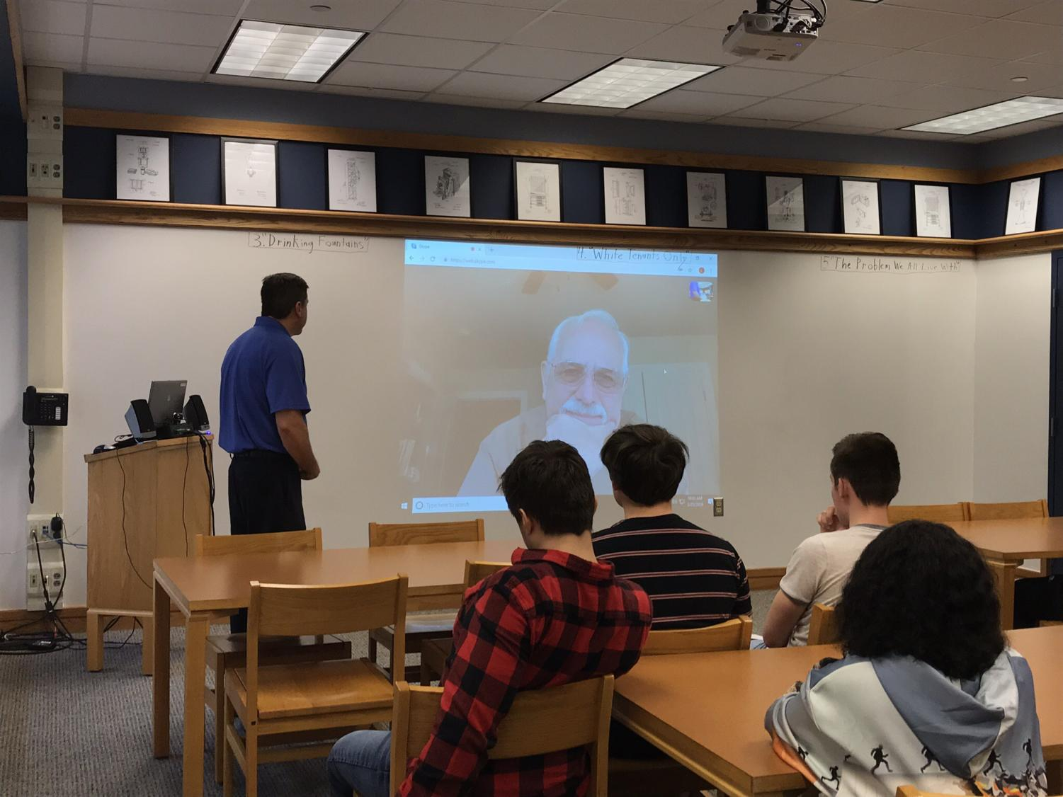 Students in Mr. Bruckner's Earth and Space class participate in a Skype call with an astronomy professor.