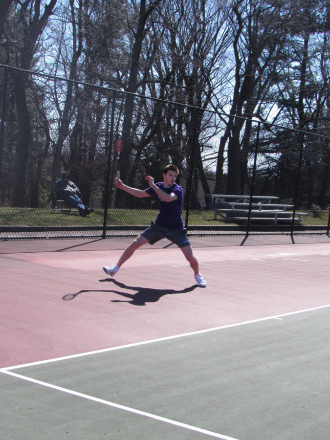 Serving+as+a+leader%3A+Junior+Remy+Davic+faces+an+opponent+at+a+match+during+the+beginning+of+the+season.+Davic+has+been+playing+tennis+since+the+third+grade+and+has+shown+success+over+the+years.