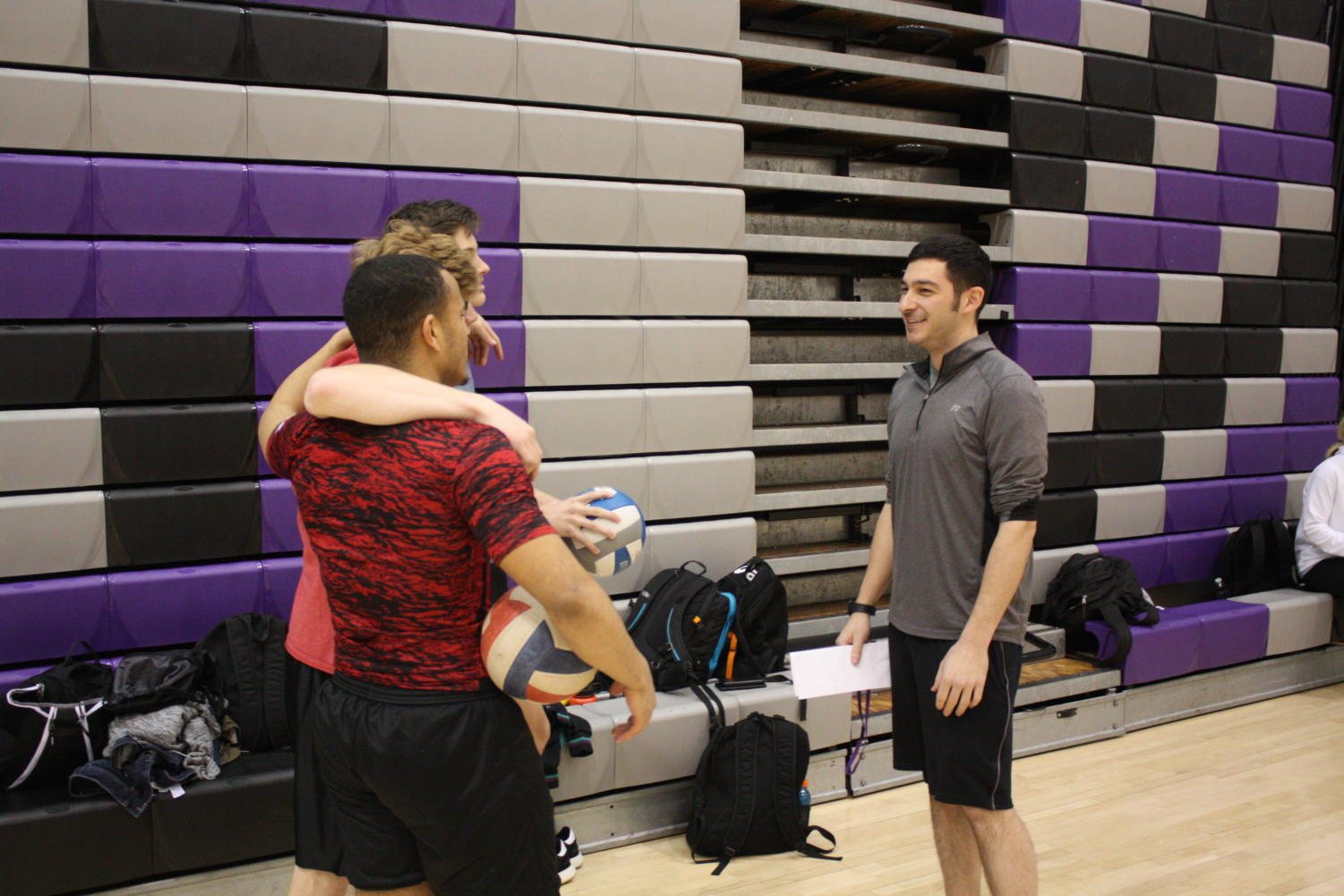 New Head coach Milan Yekich for boys volleyball talks to player during practice. Yekich takes over as head coach after the 22-year tenure of former Head Coach Eric Falcione.