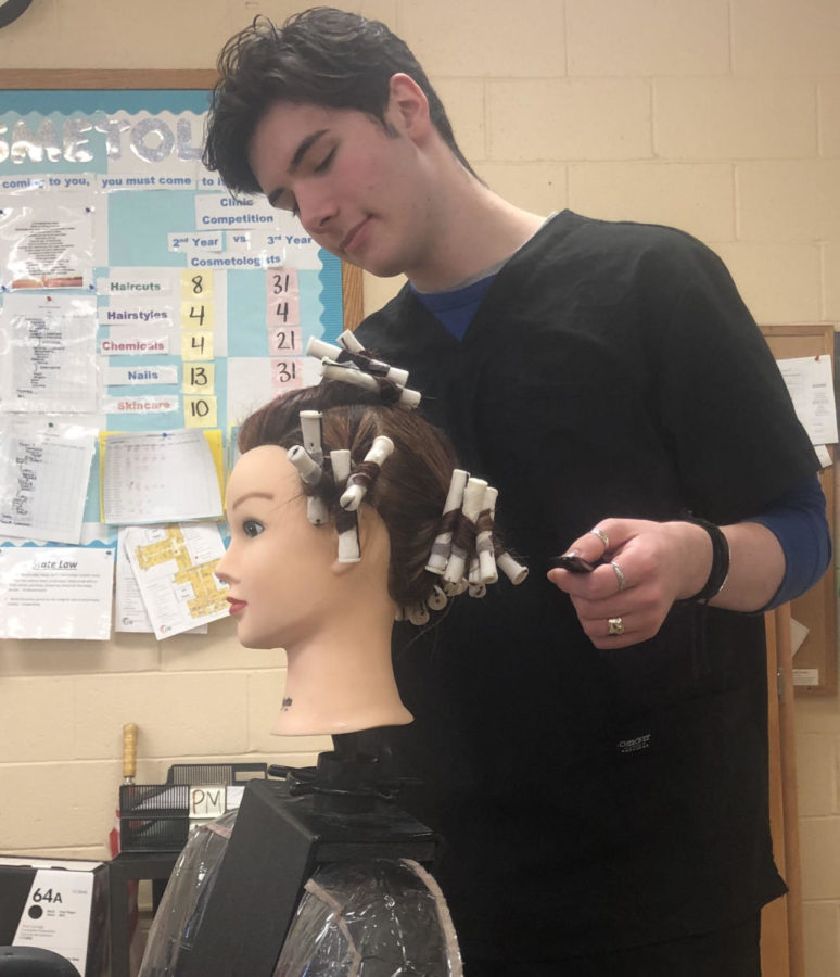 Logan+Hails+practices+hairstyling+on+a+%0Amannequin.+Hails+started+a+salon+out+of+his+home.%0A