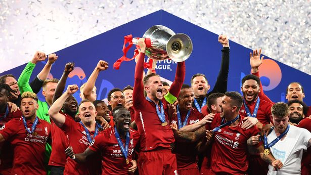 Jordan+Henderson+lifts+up+the+Champions+League+Trophy+after+defeating+Spurs.