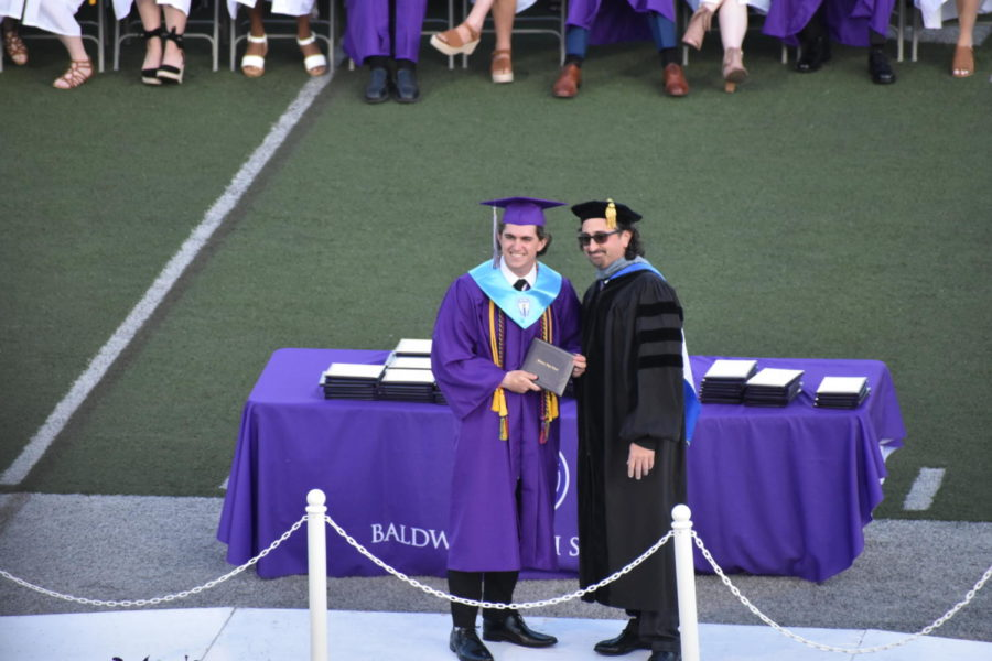 Brendan O'Malley receives his diploma from school board member Dr. Anthony J. DiCesaro.