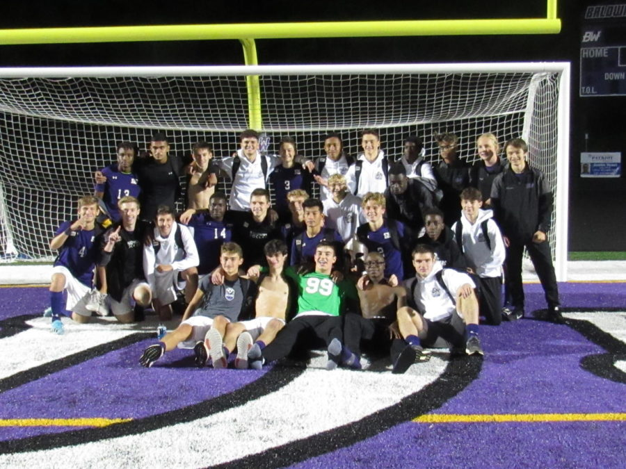 The+boys+soccer+team+celebrates+after+beating+Bethel+Park+3-1%2C+and+clinching+a+playoff+berth