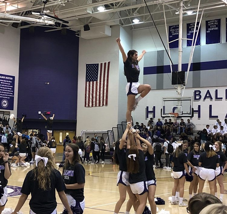Baldwin+cheerleaders+perform+at+a+pep+rally.+The+competitive+cheer+team+placed+eighth+in+the+nation+at+Disney.+