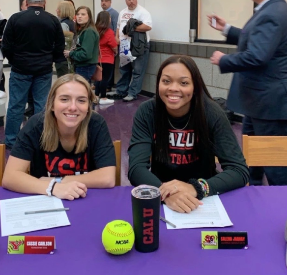 Salena Jaquay (right) and Cassie Carlson (left) have committed to playing softball in college.
