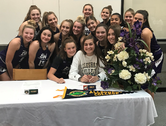 Jenna Lutz (center) committed to play Division III basketball at Allegheny College.
