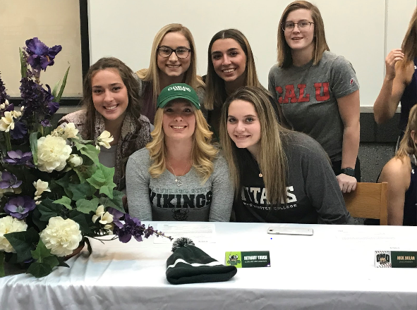 Bethany Yauch (center) will be playing tennis for Cleveland State University.