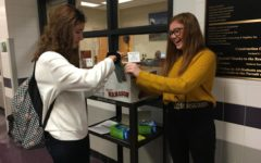 Gillian Geyer and Avery Pasquale package up cell phones for the day. About 40 students participated in the iFocus, or