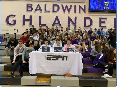 Three Baldwin students created a mock ESPN table and set it up in front of the student section at Friday's boys basketball game.