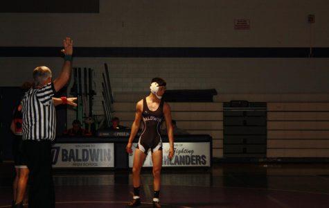 Freshmen John Starusko makes his mark on the wrestling stage.