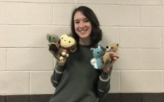 Riley Konesky shows off some of her projects. Konesky hand crochets these animals for her business.