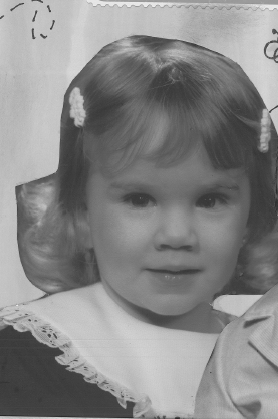 This photo is of Mrs. Krystal Schulte, English teacher, as a child.