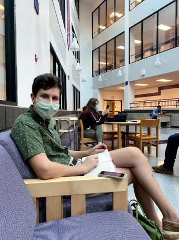 Senior Aidan Greenaway sits socially distant while working on an assignment on the first day of in person school.