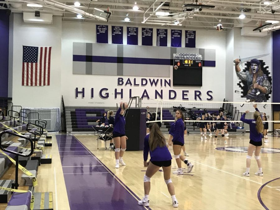 Volleyball players warm up before their match against opposing Mt. Lebanon.