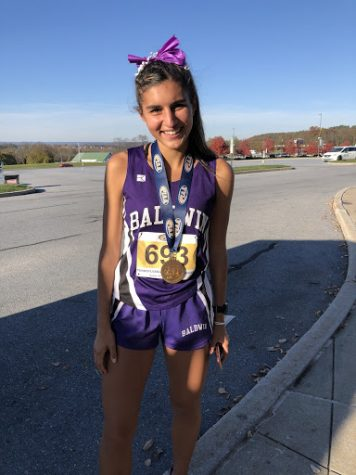 Senior Gina Bolla is the first Baldwin girls cross country runner to earn a medal at states in more than three decades.