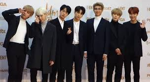 The South Korean pop group BTS has achieved success, yet still faces backlash.