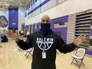 Girls basketball coach and entrepreneur Jamal Woodson lives a busy life, but prioritizes his team.