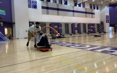 Ethan Spozarski and Edi Durakovic participate in Baldwin's in-house Special Olympics games.