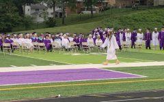 Senior Juliana Fedorko walking to receive her diploma.