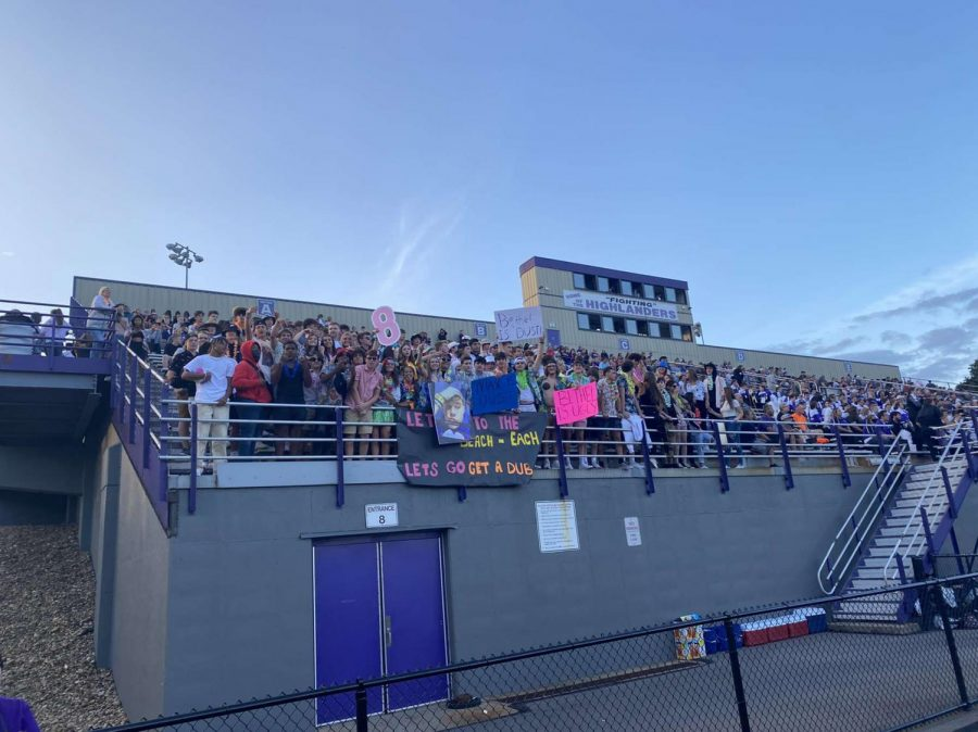 The student section cheering on players.