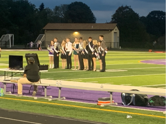 The senior class homecoming court walked down the field, before the game.