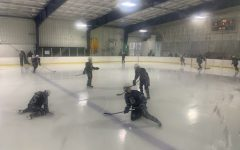 The ice hockey team warms up before the game.